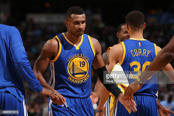 Leandro Barbosa of the Golden State Warriors celebrates with his teammates as they face the Denver Nuggets at Pepsi Center on November 22 2015 in...