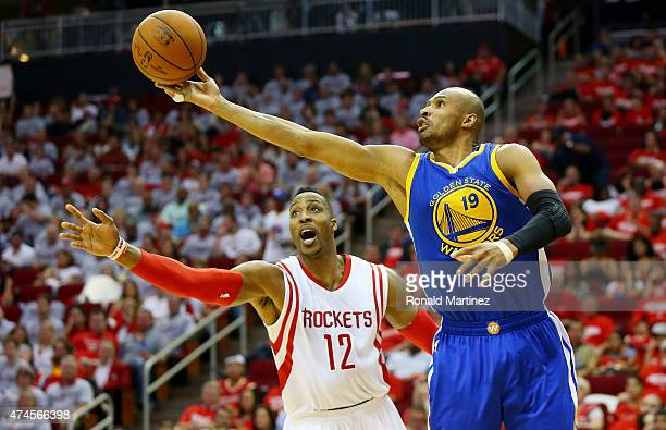 Leandro Barbosa of the Golden State Warriors controls the ball against Dwight Howard of the Houston Rockets in the fourth quarter during Game Three...