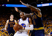 Leandro Barbosa of the Golden State Warriors drives against Iman Shumpert of the Cleveland Cavaliers in the first half during Game One of the 2015...