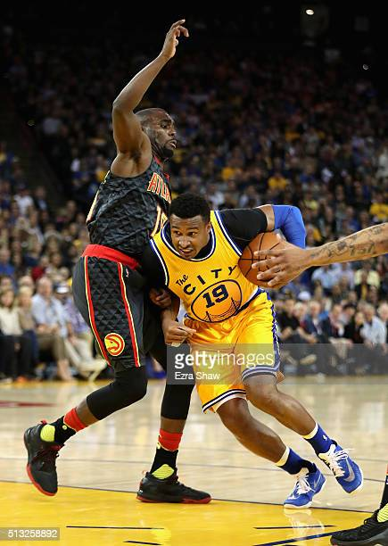 Leandro Barbosa of the Golden State Warriors drives on Tim Hardaway Jr #10 of the Atlanta Hawks at ORACLE Arena on March 1 2016 in Oakland California...