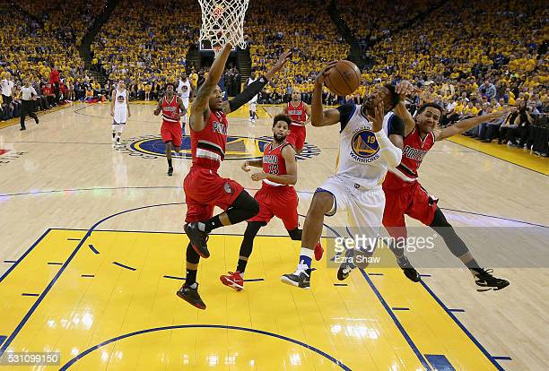 Leandro Barbosa of the Golden State Warriors goes up for a shot against Damian Lillard and CJ McCollum of the Portland Trail Blazers during Game Five...