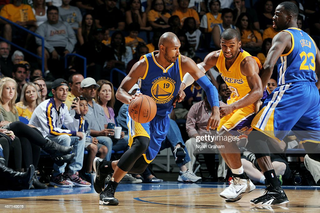 Leandro Barbosa of the Golden State Warriors handles the ball against Ronnie Price of the Los Angeles Lakers on October 12 2014 at Citizens Business...