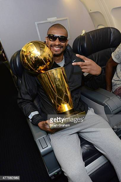 Leandro Barbosa of the Golden State Warriors holds the NBA trophy on the plane as the team travels home from Cleveland after winning the 2015 NBA...