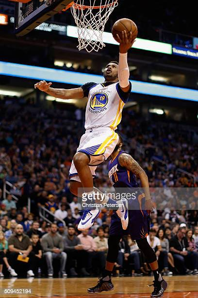 Leandro Barbosa of the Golden State Warriors lays up a shot past Markieff Morris of the Phoenix Suns during the first half of the NBA game at Talking...