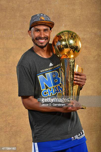 Leandro Barbosa of the Golden State Warriors poses for a portrait with the Larry O'Brien trophy after defeating the Cleveland Cavaliers in Game Six...