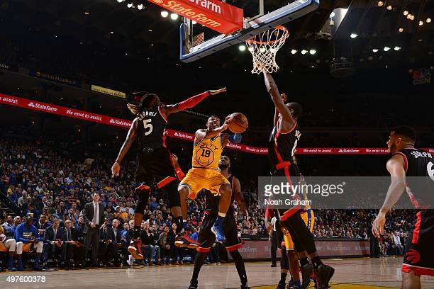Leandro Barbosa of the Golden State Warriors shoots against DeMarre Carroll of the Toronto Raptors on November 17 2015 at Oracle Arena in Oakland...