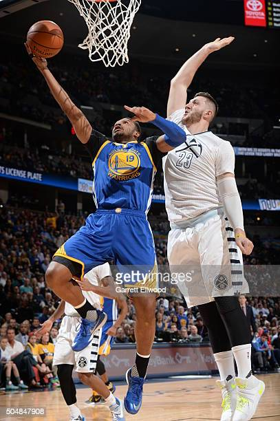 Leandro Barbosa of the Golden State Warriors shoots the ball against Jusuf Nurkic of the Denver Nuggets on January 13 2016 at the Pepsi Center in...