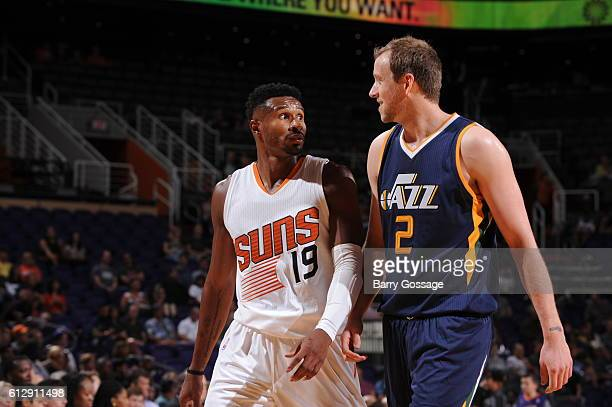 Leandro Barbosa of the Phoenix Suns chats with Joe Ingles of the Utah Jazz during a break in the action on October 5 at Talking Stick Resort Arena in...