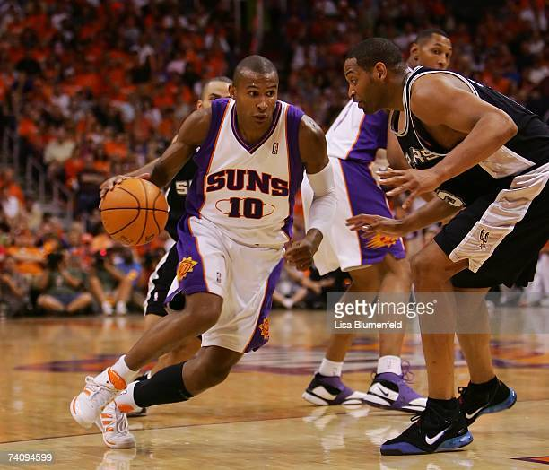 Leandro Barbosa of the Phoenix Suns drives against Robert Horry of the San Antonio Spurs in Game One of the Western Conference Semifinals during the...