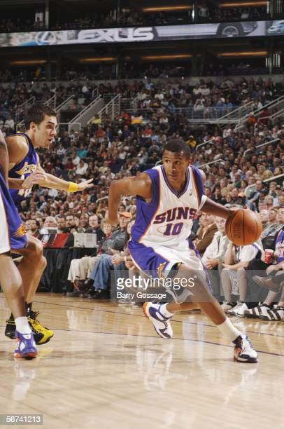 Leandro Barbosa of the Phoenix Suns drives past Sasha Vujacic of the Los Angeles Lakers during the game on January 20 at US Airways Center in Phoenix...