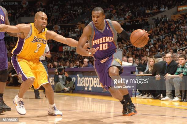 Leandro Barbosa of the Phoenix Suns drives the ball against Derek Fisher of the Los Angeles Lakers during the game on February 26 2009 at Staples...