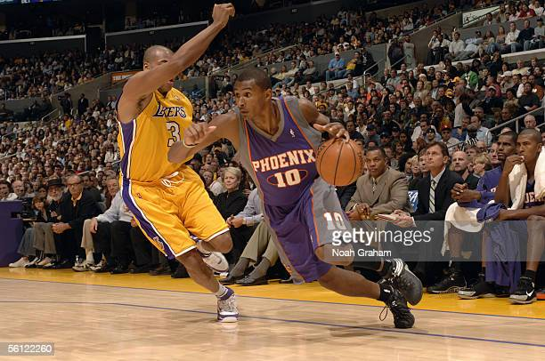 Leandro Barbosa of the Phoenix Suns drives to the basket past Devean George of the Los Angeles Lakers during the game at Staples Center on November 3...