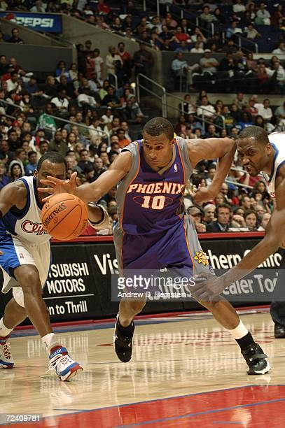Leandro Barbosa of the Phoenix Suns drives to the hoop against Cuttino Mobley and Elton Brand of the Los Angeles Clippers on November 4 2006 at...