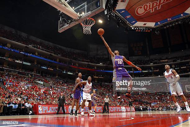Leandro Barbosa of the Phoenix Suns goes strong to the hoop against Elton Brand and Cuttino Mobley of the Los Angeles Clippers in game six of the...