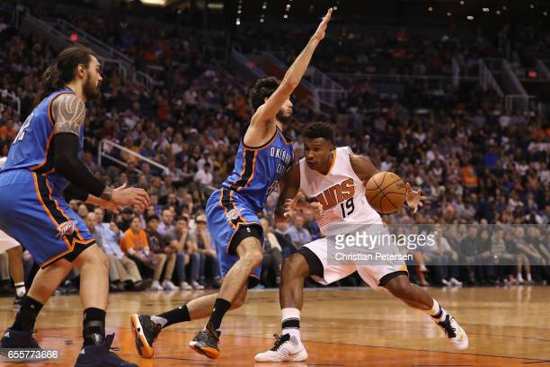 Leandro Barbosa of the Phoenix Suns handles the ball against Alex Abrines of the Oklahoma City Thunder during the second half of the NBA game at...