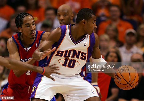 Leandro Barbosa of the Phoenix Suns looks to spin on Shaun Livingston of the Los Angeles Clippers in the second quarter of game five of the Western...