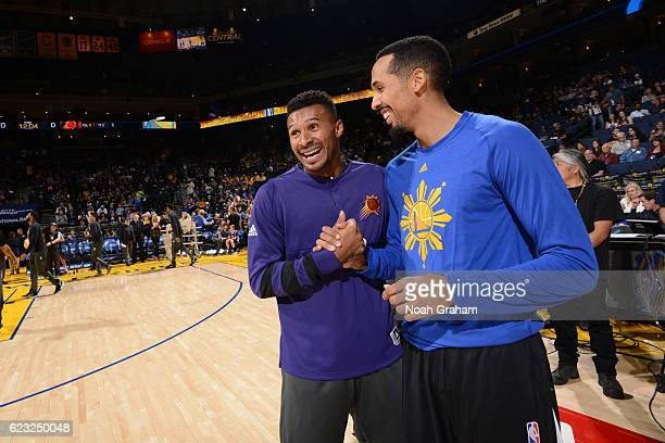 Leandro Barbosa of the Phoenix Suns shakes hands with Shaun Livingston of the Golden State Warriors before the game on November 13 2016 at Oracle...
