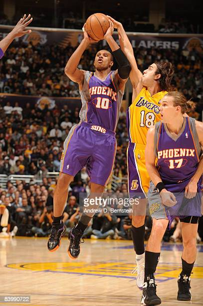 Leandro Barbosa of the Phoenix Suns shoots against Sasha Vujacic of the Los Angeles Lakers at Staples Center on December 10 2008 in Los Angeles...