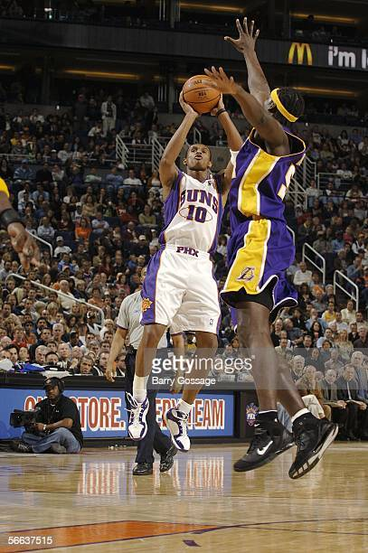 Leandro Barbosa of the Phoenix Suns shoots over Kwame Brown of the Los Angeles Lakers in an NBA game played on January 20 at US Airways Center in...
