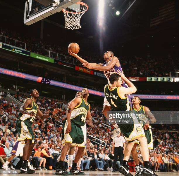 Leandro Barbosa of the Phoenix Suns takes the ball to the basket against Nick Collison of the Seattle Sonics during the game at US Airways Center on...