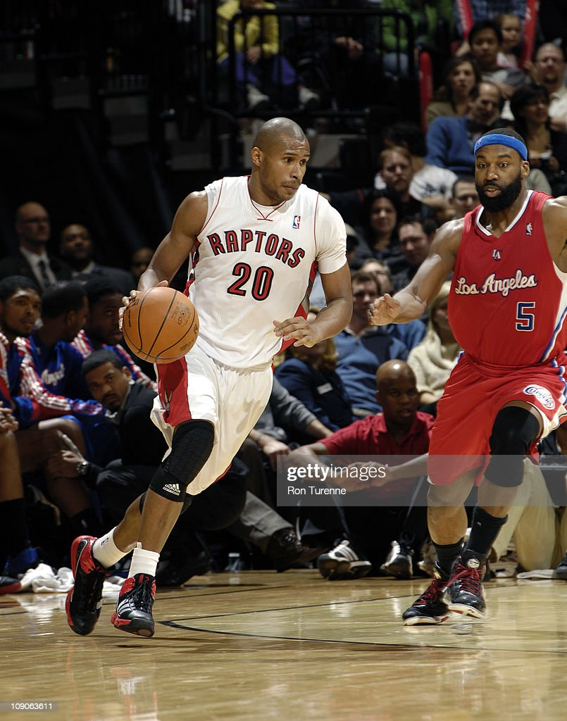 Leandro Barbosa #20 of the Toronto Raptors drives against <a gi-track='captionPersonalityLinkClicked' href=/galleries/search?phrase=Baron+Davis&family=editorial&specificpeople=201592 ng-click='$event.stopPropagation()'>Baron Davis</a> #5 of the Los Angeles Clippers on February 13, 2011 at the Air Canada Centre in Toronto, Ontario, Canada.