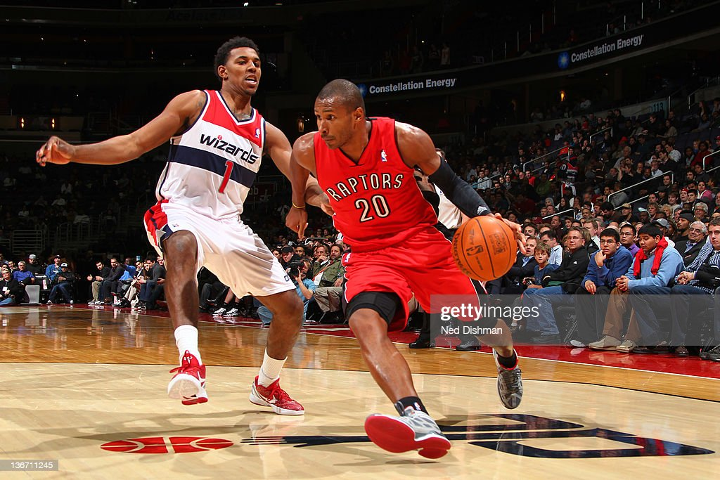 Leandro Barbosa #20 of the Toronto Raptors drives against Nick Young #1 of the Washington Wizards during the game at the Verizon Center on January 10, 2012 in Washington, DC.
