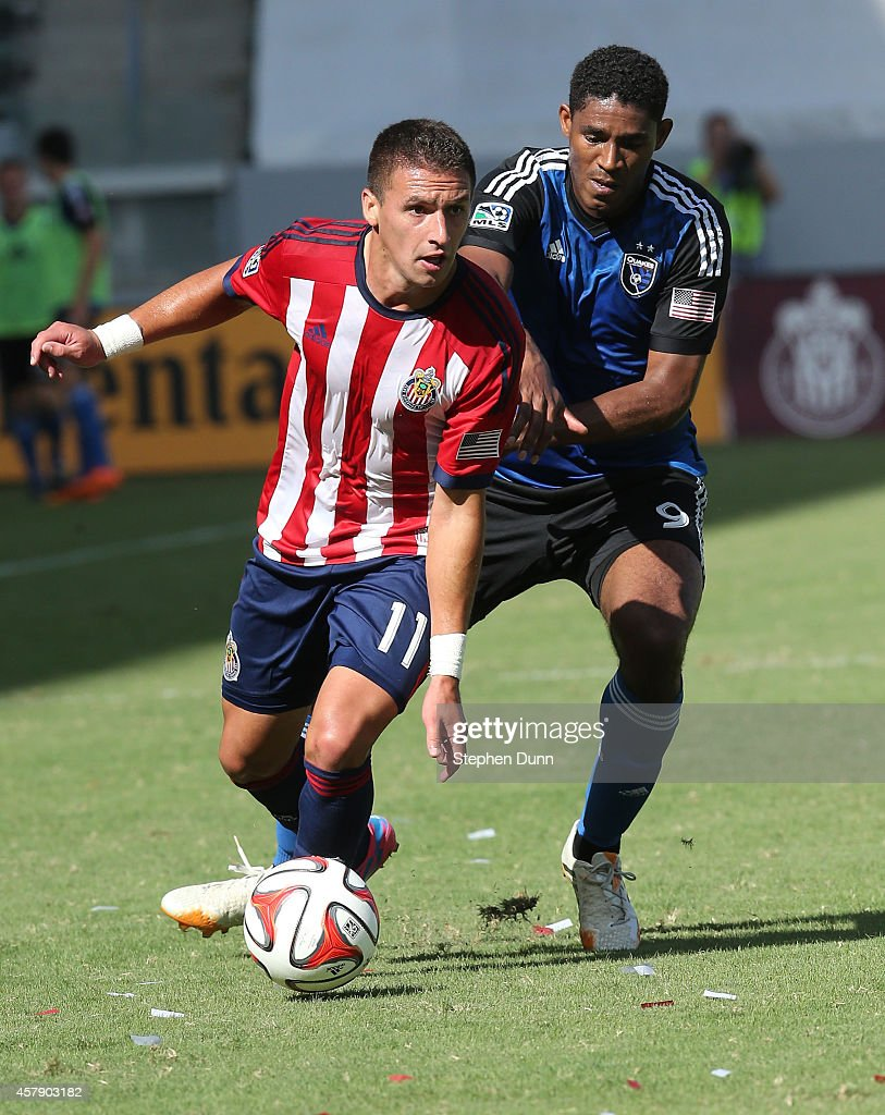 Leandro Barrera of Chivas USA controls the all against Khari Stephenson of the San Jose Earthquakes at StubHub Center on October 26 2014 in Los...