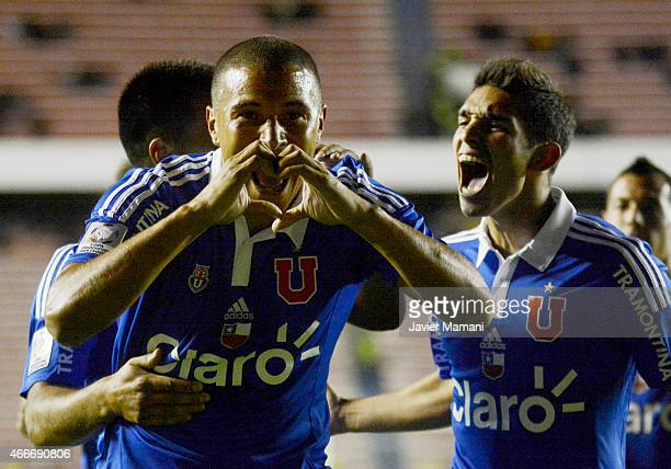 Leandro Benegas of U de Chile celebrates with his teammates after scoring the opening goal during a match between The Strongest and U de Chile as...