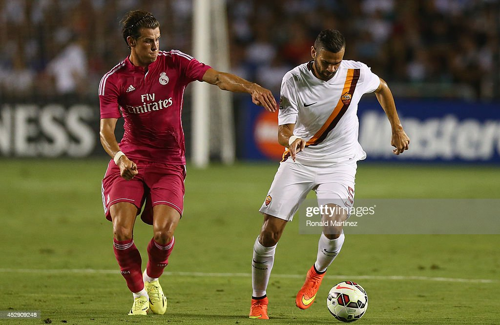 Leandro Castan #5 of AS Roma dribbles the ball past Gareth Bale #11 of Real Madrid during a Guinness International Champions Cup 2014 game at Cotton Bowl on July 29, 2014 in Dallas, Texas.