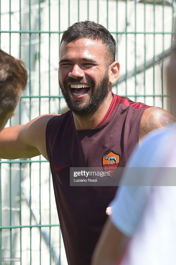 <a gi-track='captionPersonalityLinkClicked' href=/galleries/search?phrase=Leandro+Castan&family=editorial&specificpeople=5891971 ng-click='$event.stopPropagation()'>Leandro Castan</a> of AS Roma laughs during an AS Roma training session on July 9, 2015 in Pinzolo near Trento, Italy.