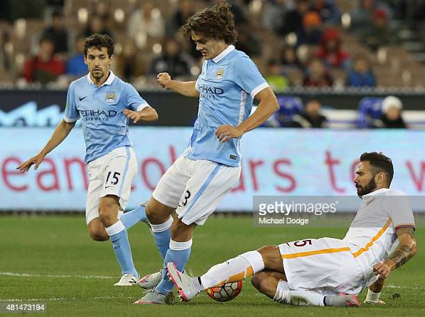 Leandro Castan of AS Roma tackles Enes Unal of Manchester City during the International Champions Cup match between Manchester City and AS Roma at...
