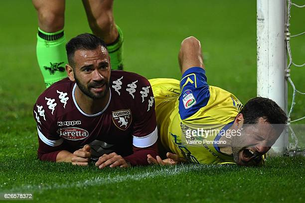 Leandro Castan of FC Torino clashes with Massimo Gobbi of AC ChievoVerona during the Serie A match between FC Torino and AC ChievoVerona at Stadio...