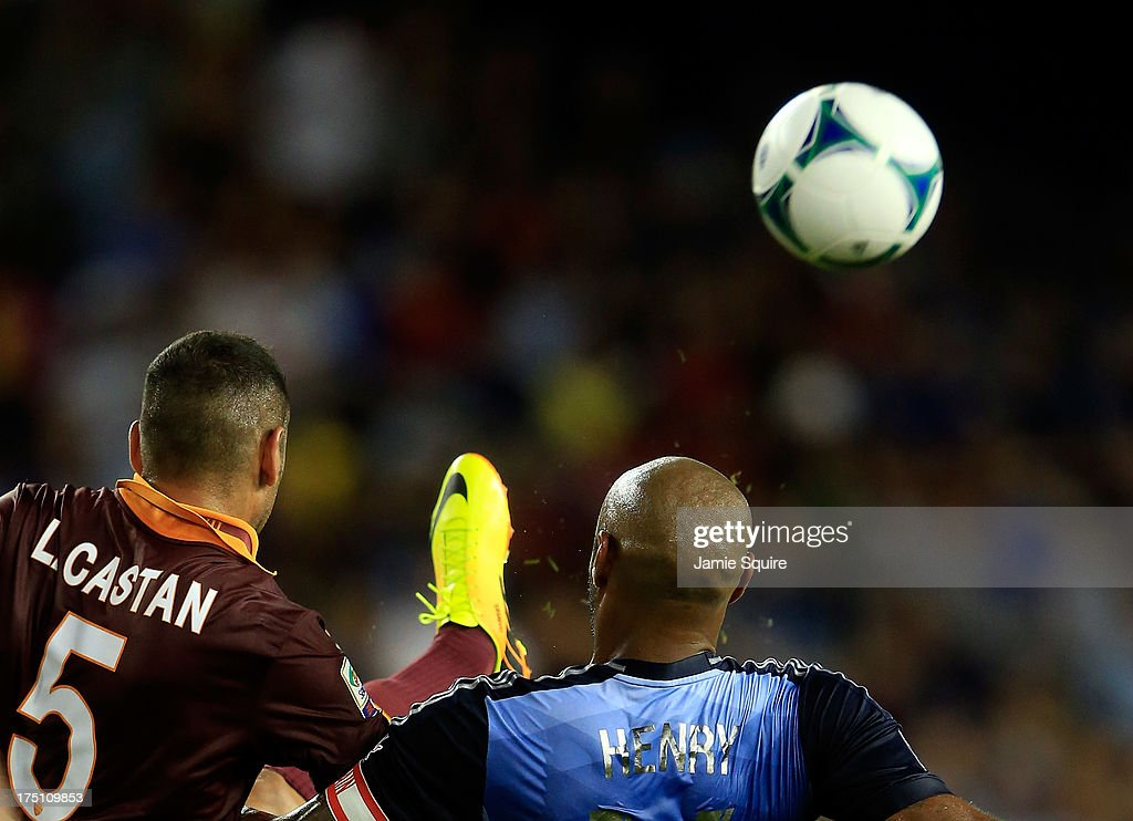Leandro Castán #5 of AS Roma and <a gi-track='captionPersonalityLinkClicked' href=/galleries/search?phrase=Thierry+Henry&family=editorial&specificpeople=167275 ng-click='$event.stopPropagation()'>Thierry Henry</a> #14 of the MLS All-Stars battle for a ball during the 2013 Major League Soccer All Star Game at Sporting Park on July 31, 2013 in Kansas City, Kansas.