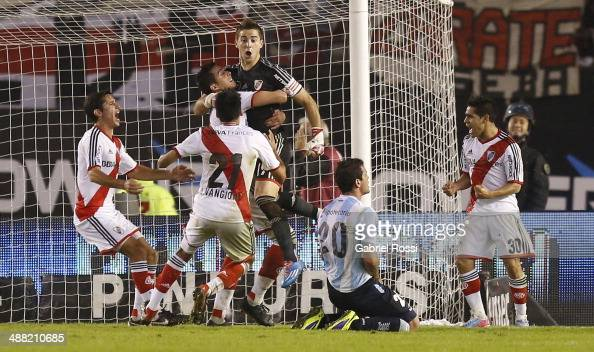 Leandro Chichizola goalkeeper of River Plate celebrates with his teammates after stopping a penalty during a match between River Plate and Racing...