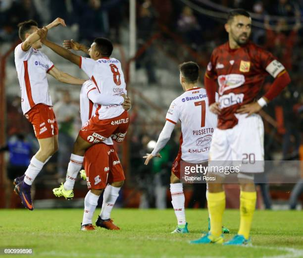 Leandro Cuomo of Huracan celebrates his team's third goal during a second leg match between Huracan and Deportivo Anzoategui as part of first round...