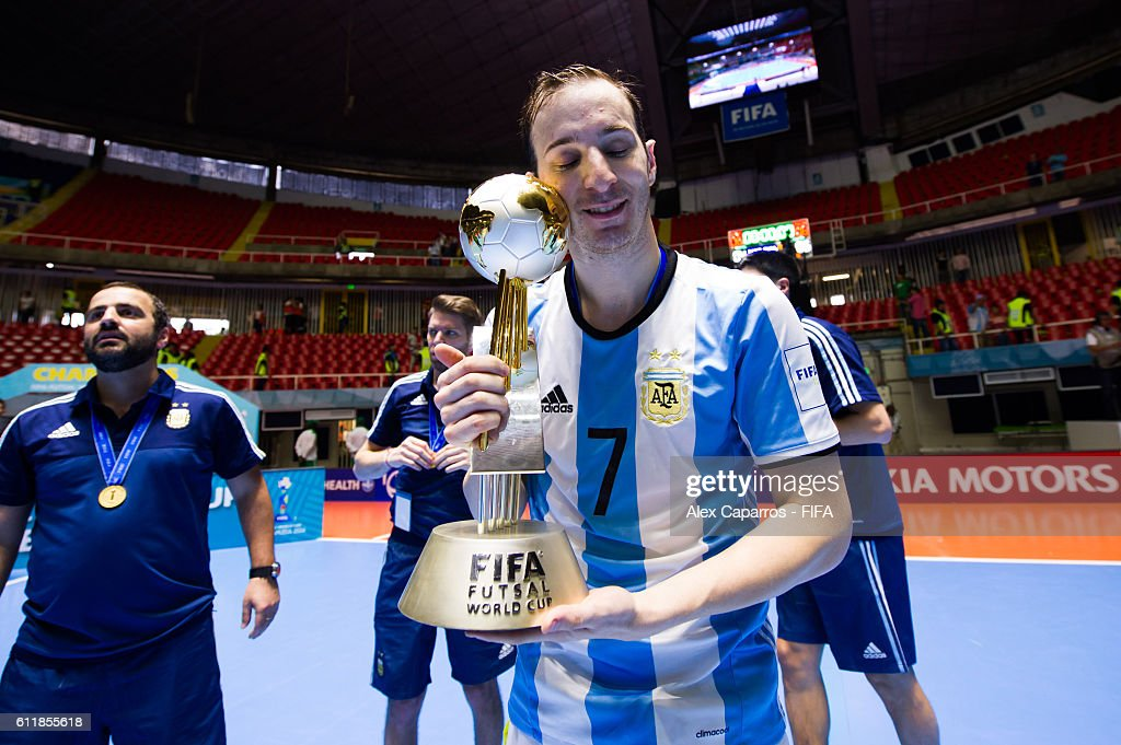 Leandro Cuzzolino of Argentina poses with the trophy during the FIFA Futsal World Cup final between Russia and Argentina at Coliseo el Pueblo on October 1, 2016 in Cali, Colombia.