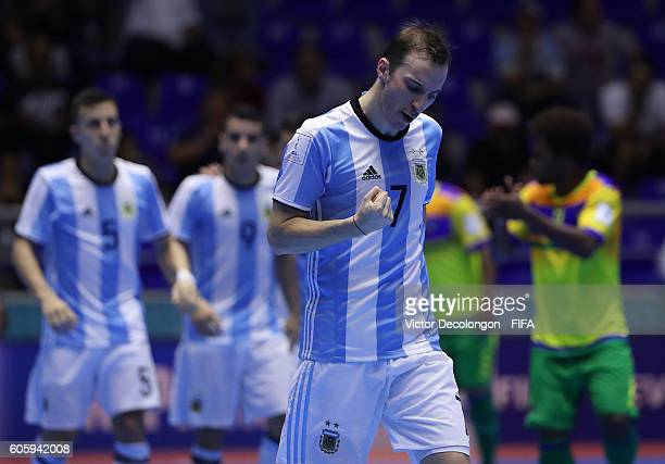 Leandro Cuzzolino of Argentina pumps his fist on his way back to his side after a goal by teammate Alamiro Vaporaki not in photo during Group E match...