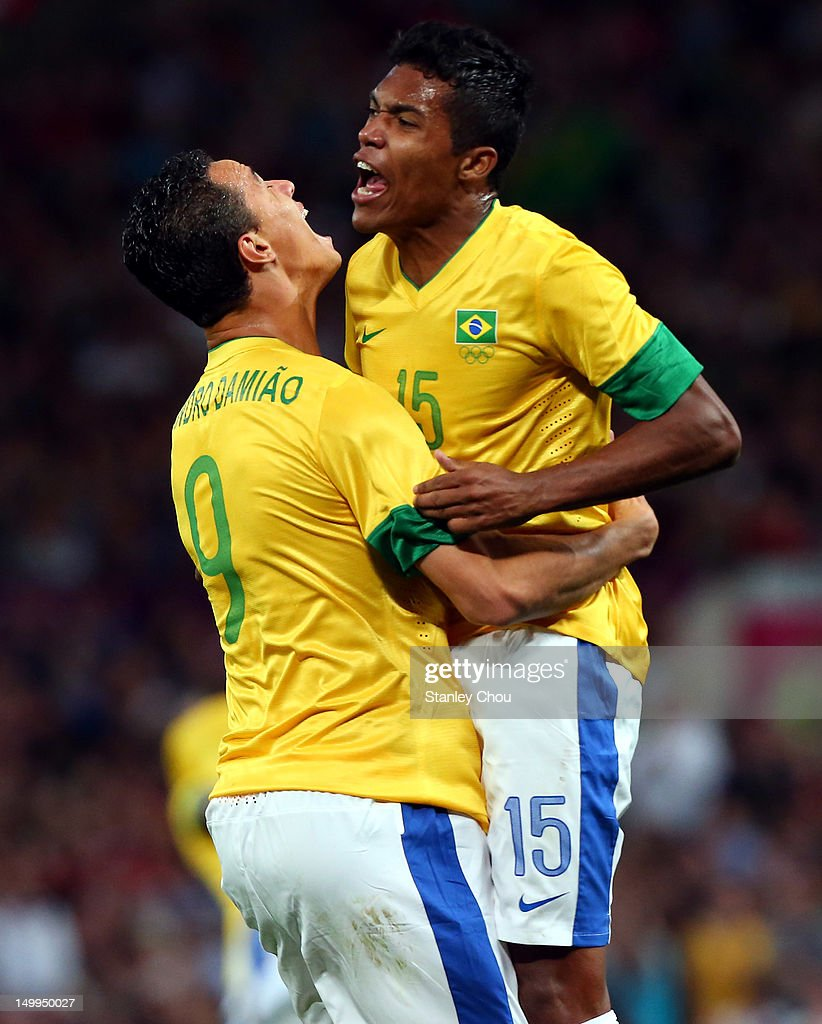 <a gi-track='captionPersonalityLinkClicked' href=/galleries/search?phrase=Leandro+Damiao&family=editorial&specificpeople=7145241 ng-click='$event.stopPropagation()'>Leandro Damiao</a> of Brazil (9) celebrates with Alex Sandro after scoring the 2nd goal against Korea during the Men's Football Semi Final match between Korea and Brazil, on Day 11 of the London 2012 Olympic Games at Old Trafford on August 7, 2012 in Manchester, England.