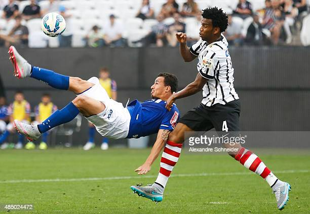 Leandro Damiao of Cruzeiro and Gil of Corinthians in action during the match between Corinthians and Cruzeiro for the Brazilian Series A 2015 at...