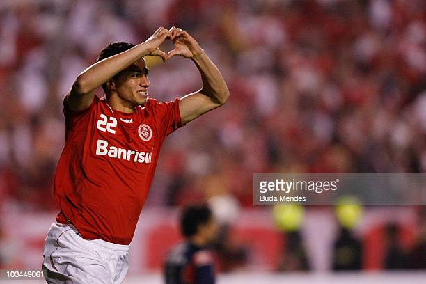 Leandro Damiao of Internacional celebrates a scored goal against Chivas during a match as part of the 2010 Copa Santander Libertadores at Beira Rio...