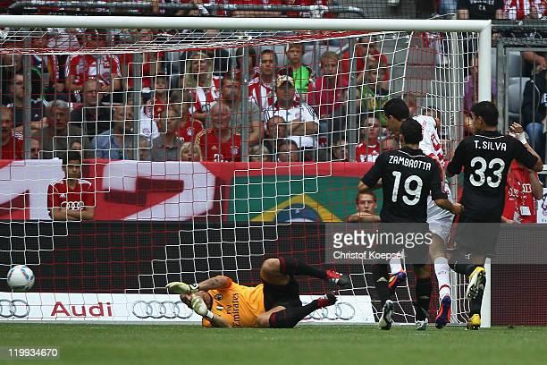 Leandro Damiao of Porto Alege scores the first goal against Christian Abbiati Gianluca Zambrotta Thiago SilvaThiago Silva of Milan during the Audi...