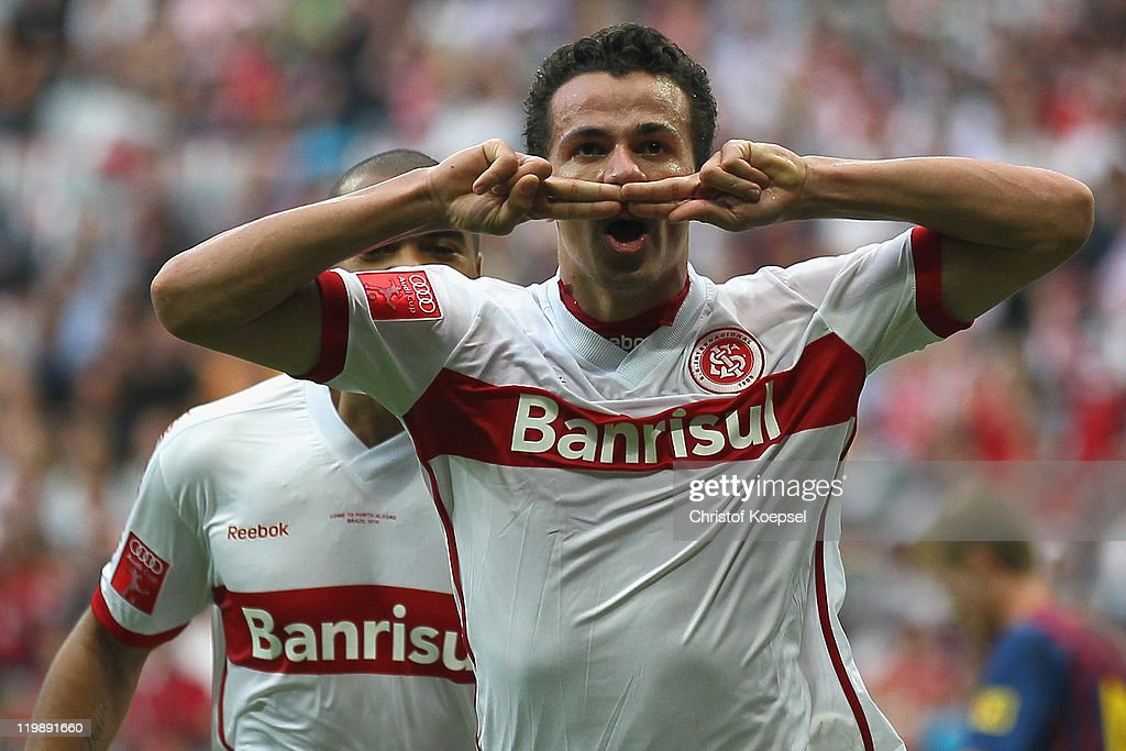 <a gi-track='captionPersonalityLinkClicked' href=/galleries/search?phrase=Leandro+Damiao&family=editorial&specificpeople=7145241 ng-click='$event.stopPropagation()'>Leandro Damiao</a> of Porto Alegre celebrates the second goal during the Audi Cup match between FC Barcelona and International de Porto Alegre at Allianz Arena on July 26, 2011 in Munich, Germany.