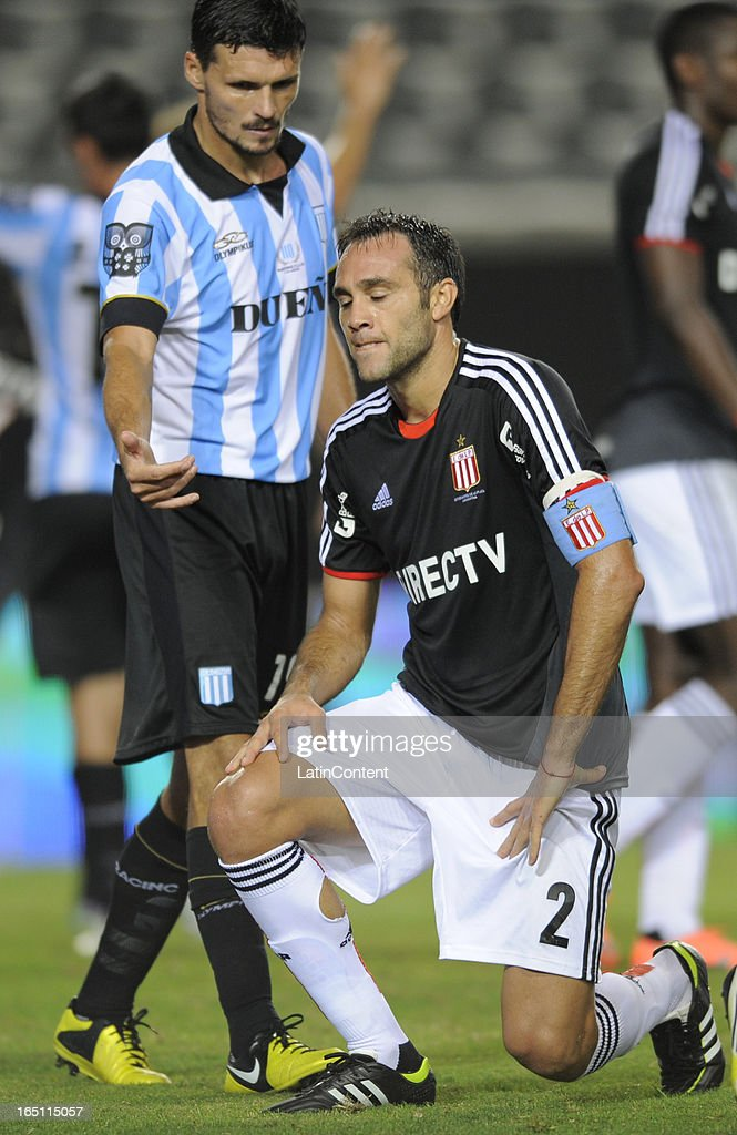Leandro Desabato (R) of Estudiantes de La Plata reacts during a match between Estudiantes and Racing as part of the 7th round of the Torneo Final 2013 at Ciudad de La Plata stadium on March 30, 2013 in La Plata, Argentina.