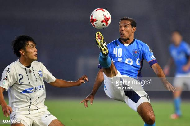 Leandro Domingues of Yokohama FC and Masayuki Okuyama of Machida Zelvia compete for the ball during the JLeague J2 match between Yokohama FC and...