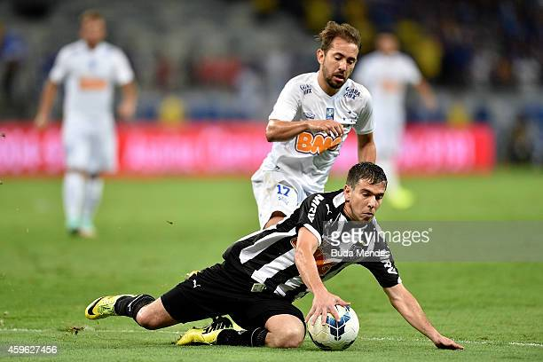 Leandro Donizete of Atletico MG struggles for the ball with a Everton Ribeiro of Cruzeiro during a match between Atletico MG and Cruzeiro as part of...