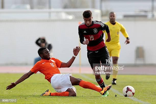 Leandro Fernandes of Netherlands challenges Timothy Tillman of Germany during the UEFA Under17 match between U17 Netherlands v U17 Germany on...