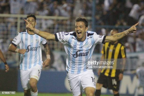 Leandro Gonzalez of Argentina's Atletico Tucuman celebrates after scoring the team's second goal against Uruguay's Penarol during their Copa...