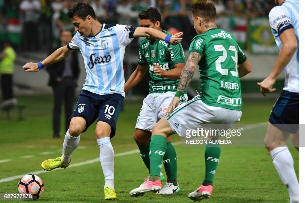 Leandro Gonzalez of Argentina's Atletico Tucuman vies for the ball with Roger Guedes of Brazil's Palmeiras during their 2017 Copa Libertadores...