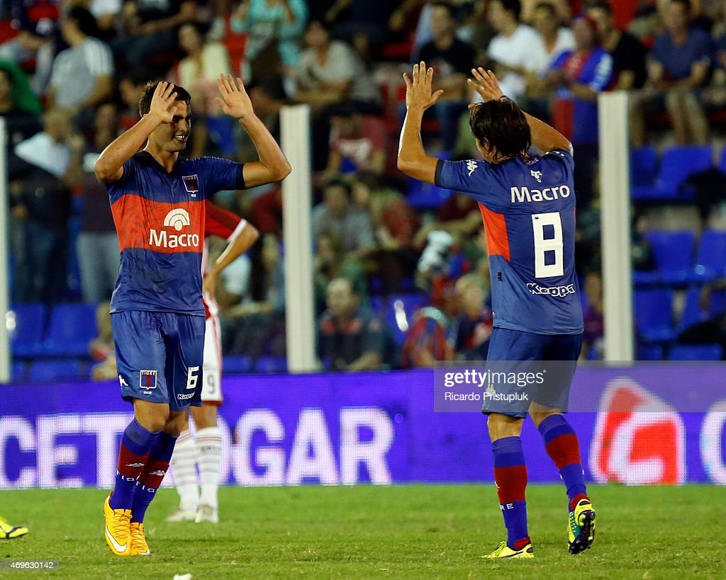 Leandro Gonzalez Pirez of Tigre (L) celebrates with his teammate Martin Galmarini (R) during a match between Tigre and Estudiantes as part of 9th round of Torneo Primera Division at Jose Dellagiovanna Stadium on April 13, 2015 in Victoria, Argentina.
