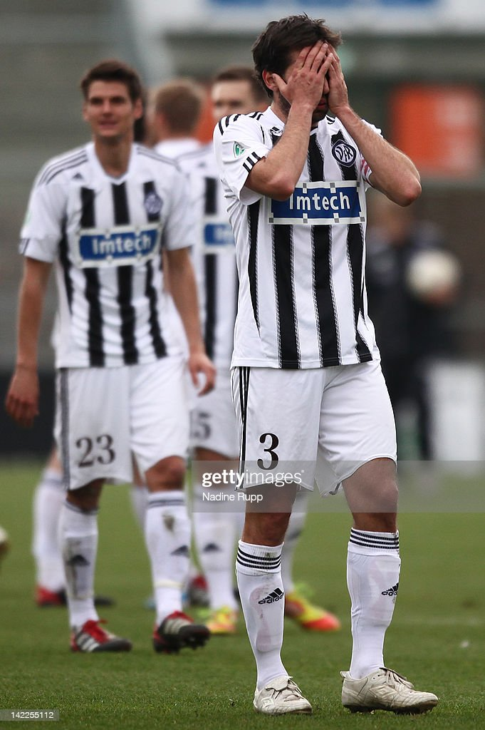 Leandro Grech and Andreas Hofmann of Aalen look dejected after loosing the Third League match between VfR Aalen and Chemnitzer FC at ScholzArena on...